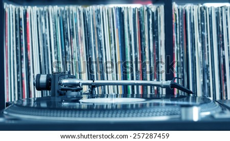 Dj turntable on vinyl background, closeup - stock photo