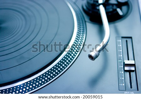 DJ turntable with no needle installed on it - stock photo
