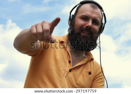 DJ with headphones on the sky background