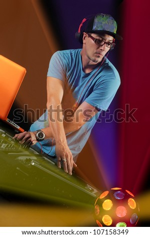 DJ with table and Colorful Club Lights - stock photo