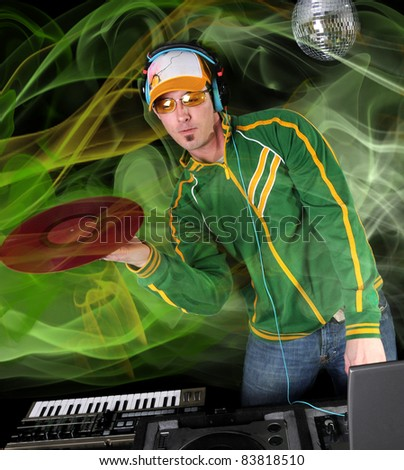 DJ with table, disco ball and green smoke in the background - stock photo