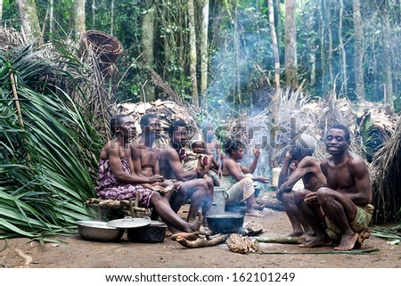 DJA FOREST, CAMEROON - AUG 5: Family of pygmies in the forest, forest pygmies Could Lose Their habitat due to logging companies and ivory traffickers on Aug 5, 2013 in the Dja forest, Cameroon - stock photo