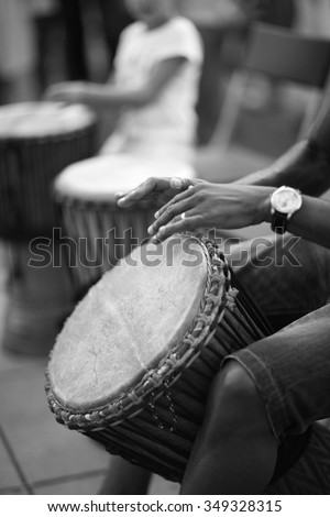 Djembe rhythms, male hands playing african traditional drums  - stock photo