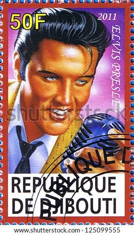 DJIBOUTI - CIRCA 2011: A postage stamp printed in the Republic of Djibouti showing an illustration of Elvis Presley holding a microphone, circa 2011 - stock photo