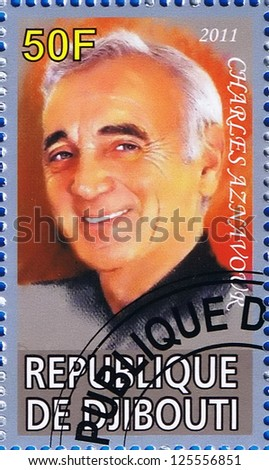 DJIBOUTI - CIRCA 2011: A postage stamp printed in the Republic of Djibouti showing Charles Aznavour, circa 2011 - stock photo