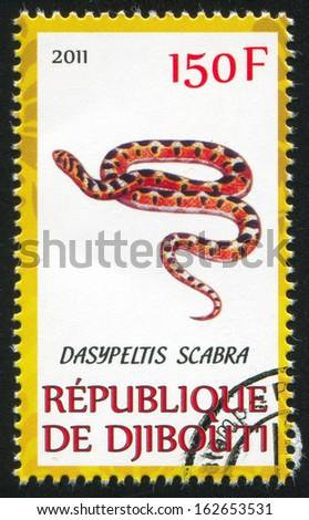 DJIBOUTI - CIRCA 2011: stamp printed by Djibouti, shows common snake, circa 2011 - stock photo