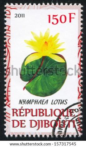 DJIBOUTI - CIRCA 2011: stamp printed by Djibouti, shows Lotus, circa 2011 - stock photo