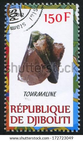 DJIBOUTI - CIRCA 2012: stamp printed by Djibouti, shows Tourmaline, circa 2012 - stock photo