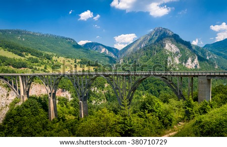 Djurdjevic old big bridge over the Tara river canyon. Touristic attraction, one of the biggest old bridges in Europe. Montenegro. - stock photo