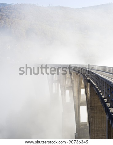 Djurdjevica Tara Bridge is a concrete arch bridge over the Tara River in northern Montenegro. It was built between 1937 and 1940, it's 365m long and the roadway stands 172 metres above the river. - stock photo