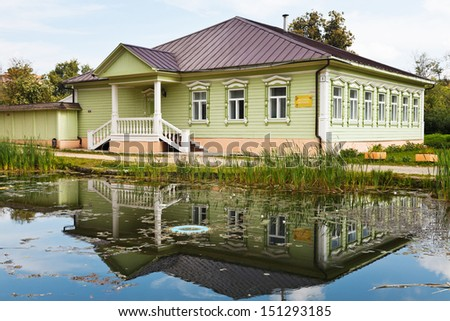 DMITROV, RUSSIA - AUGUST 14: old russian wooden house in Dmitrov Kremlin in Russia on August 14, 2013, The house was built in the late XIX century and now it is living museum rooms