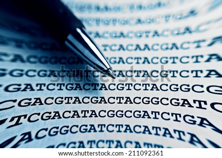 DNA encoding with pen. Text with nucleobases. - stock photo