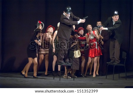 "DNEPROPETROVSK, UKRAINE - APR 24: Members of the Theatre ""Anthill"" perform ""Pilferers are different you do know"" at the State Russian Drama Theatre on April 24, 2013 in Dnepropetrovsk, Ukraine"