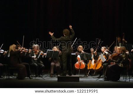 "DNEPROPETROVSK, UKRAINE - DEC.17: ""Four seasons"" Chamber Orchestra - main conductor Druzelub Yanakiev perform music of  Mozart, Elgar, Brittain, Dvorak on Dec. 17, 2012 in Dnepropetrovsk, Ukraine - stock photo"