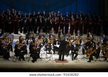 "DNEPROPETROVSK, UKRAINE - DECEMBER 26: ""Christmas Oratorio"" by Hilarion  performed by Symphony Orchestra and chorus of the Kharkov Philharmonic on December 26, 2011 in Dnepropetrovsk, Ukraine - stock photo"
