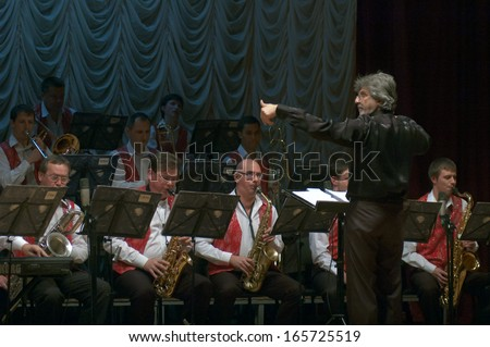 DNEPROPETROVSK, UKRAINE - DECEMBER 3: Members of the Philharmonic Society Jazz Orchestra perform on December 3, 2013 in Dnepropetrovsk, Ukraine