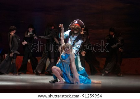 "DNEPROPETROVSK, UKRAINE  DECEMBER 17: Unidentified children, , ages 14 years old, perform musical spectacle "" Red Sails"" on December 17, 2011 in Dnepropetrovsk, Ukraine"