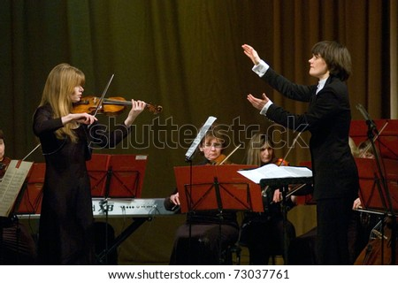 "DNEPROPETROVSK, UKRAINE –  FEB. 2: Violinist  Pivnenko and Symphonic Orchestra - main conductor Ponomarchuk performed music of Vivaldi's ""Four seasons"" on Feb. 2,2008 in Dnepropetrovsk, Ukraine"