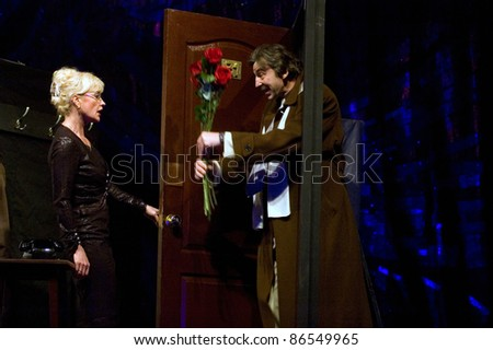 "DNEPROPETROVSK, UKRAINE - FEBRUARY 24: Members of the Dnepropetrovsk State Russian Drama Theatre perform "" Man as a gift "" on February 24, 2011 in Dnepropetrovsk, Ukraine"
