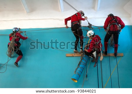 DNEPROPETROVSK, UKRAINE - JANUARY 28: Unidentified participants in action during urban mountaineering competitions  on January 28, 2012 in Dnepropetrovsk, Ukraine