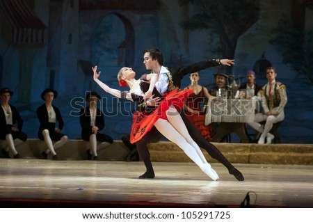 "DNEPROPETROVSK, UKRAINE - JUNE 13: Members of the Dnepropetrovsk State Opera and Ballet Theatre perform ""Don Quixote"" on June 13, 2012 in Dnepropetrovsk, Ukraine - stock photo"