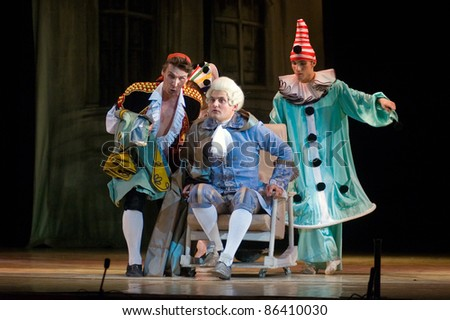"DNEPROPETROVSK, UKRAINE - JUNE 25: Members of the Dnepropetrovsk State Opera and Ballet Theatre perform "" The Barber of Seville "" on June 25, 2011 in Dnepropetrovsk, Ukraine - stock photo"