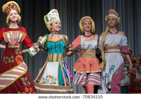 DNEPROPETROVSK, UKRAINE - MARCH 25: Ukrainian children demonstrate clothes for unidentified young Ukrainian designer copyright at FASHION TOWN  show on March 25, 2010 in Dnepropetrovsk, Ukraine