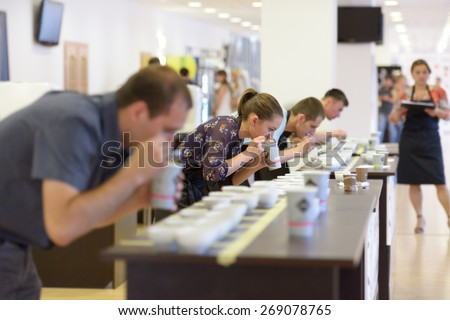 DNEPROPETROVSK, UKRAINE - MAY 31, 2013: Competitors during 5th Ukrainian Cup Tasters Championship in Dnepropetrovsk, Ukraine on May 31, 2013 - stock photo