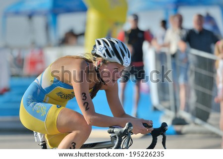 DNEPROPETROVSK, UKRAINE - MAY 24, 2014: Diana Mashevska of Ukraine races in the cycling stage of ETU Sprint Triathlon European cup. It's the first time Triathlon European Cup take place in Ukraine
