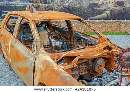 Dnepropetrovsk, Ukraine - May 19, 2016: Open air museum dedicated to war in the Donbass. Burned car as a result of war in the Donbass - stock photo