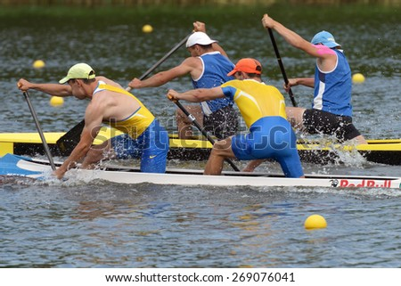 DNEPROPETROVSK, UKRAINE - MAY 29, 2013: Unidentified paddlers in canoe racing during Ukrainian paddling championships. Dnepropetrovsk rowing canal is the main Ukrainian sport arena in kayaking - stock photo