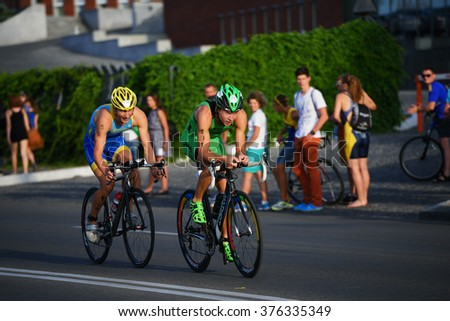 DNEPROPETROVSK, UKRAINE - MAY 24, 2014: Yegor Martynenko (right) and Sergiy Kokhan, both of Ukraine, leading in the second stage of ETU Sprint Triathlon European cup - stock photo