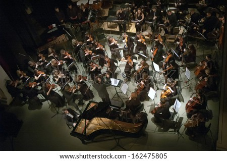 DNEPROPETROVSK, UKRAINE - NOVEMBER 11: Youth Symphony Orchestra FESTIVAL - main conductor Dmitry Logvin perform music of  Prokofiev and Shostakovich on November 11, 2013 in Dnepropetrovsk, Ukraine - stock photo