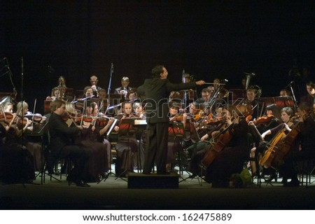 DNEPROPETROVSK, UKRAINE - NOVEMBER 11: Youth Symphony Orchestra FESTIVAL - main conductor Dmitry Logvin perform music of  Prokofiev and Shostakovich on November 11, 2013 in Dnepropetrovsk, Ukraine