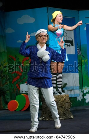 "DNEPROPETROVSK, UKRAINE - SEPTEMBER 14: Members of the Dnepropetrovsk State Russian Drama Theatre perform ""Grandma's tales"" on September 14, 2011 in Dnepropetrovsk, Ukraine"