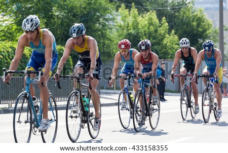 Dnipro, Ukraine -  June 4, 2016: A group of men on bikes in individual race within the Championship of Ukraine in triathlon for youth and elite Olympic distance.