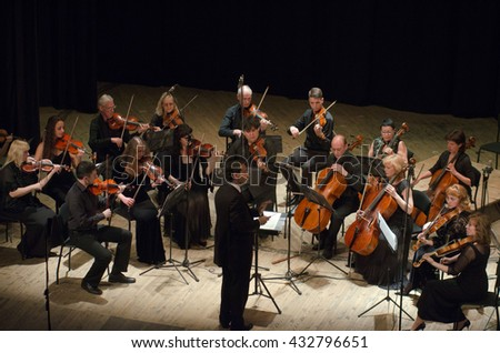 DNIPRO, UKRAINE - JUNE 6, 2016: FOUR SEASONS Chamber Orchestra - main conductor Dmitry Logvin perform at the State Russian Drama Theatre