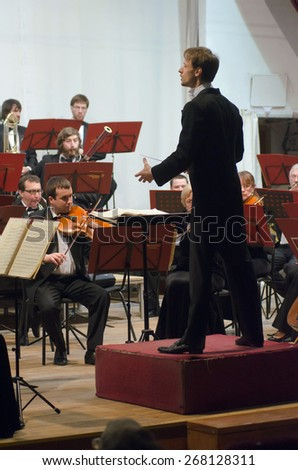DNIPROPETROVSK, UKRAINE - APRIL 9: Members of the Symphonic Orchestra - main conductor Ivan Cherednichenko perform on April 9, 2015 in Dnipropetrovsk, Ukraine