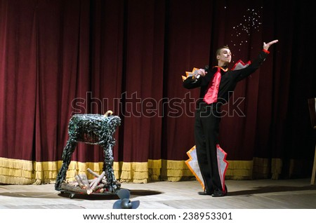 DNIPROPETROVSK, UKRAINE - DECEMBER 19: Members of the Dnipropetrovsk State Russian Drama Theatre perform PUSS IN BOOTS on December 19, 2014 in Dnipropetrovsk, Ukraine - stock photo