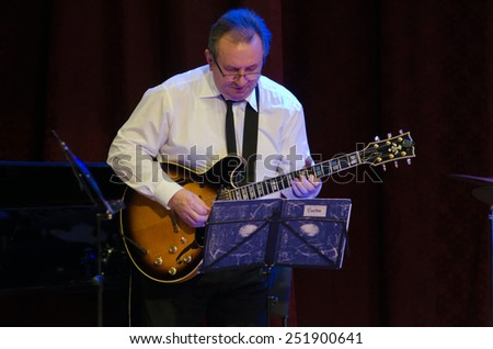 DNIPROPETROVSK, UKRAINE - FEBRUARY 10: Famous guitarist Victor Kovalenko and members of the Philharmonic Society Jazz Orchestra perform on February 10, 2015 in Dnipropetrovsk, Ukraine - stock photo