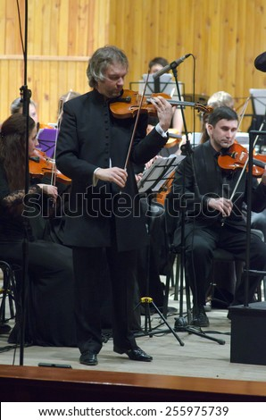 DNIPROPETROVSK, UKRAINE -?? FEBRUARY 23: Famous violinist Alksandr Trostyansky and Youth Symphony Orchestra FESTIVAL  perform at the Conservatory on Feb. 23, 2015 in Dnipropetrovsk, Ukraine - stock photo
