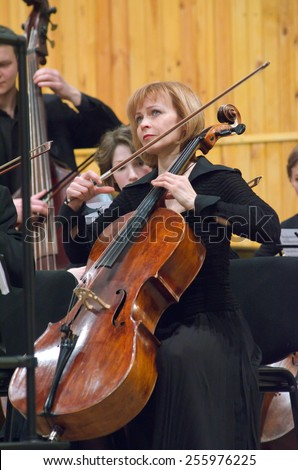 DNIPROPETROVSK, UKRAINE - FEBRUARY 23: Members of the Youth Symphony Orchestra FESTIVAL perform at the Conservatory on February 23, 2015 in Dnipropetrovsk, Ukraine - stock photo