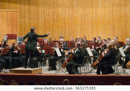 DNIPROPETROVSK, UKRAINE - JANUARY 16, 2016: Members of the Symphonic Orchestra - main conductor Natalia Ponomarchuk perform at the Conservatory. - stock photo