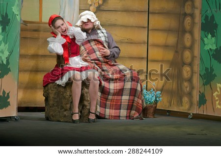 DNIPROPETROVSK, UKRAINE - JUNE 14, 2015: Members of the Dnipropetrovsk State Russian Drama Theatre perform Curious Little Red Riding Hood.