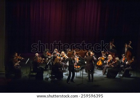 DNIPROPETROVSK, UKRAINE - MARCH 9: FOUR SEASONS Chamber Orchestra - main conductor Dmitry Logvin perform at the State Russian Drama Theatre on March 9, 2015 in Dnipropetrovsk, Ukraine