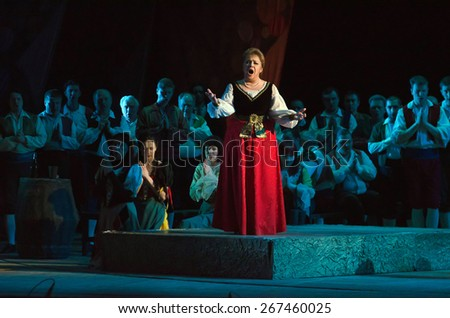 DNIPROPETROVSK, UKRAINE - MARCH 26: Members of the Dnipropetrovsk State Opera and Ballet Theatre perform CAVALLERIA RUSTICANA on March 26, 2015 in Dnipropetrovsk, Ukraine - stock photo