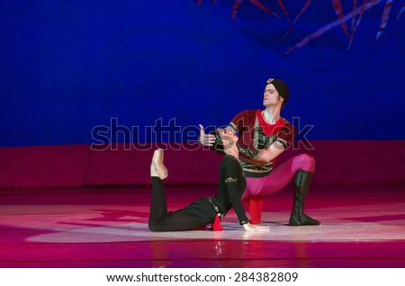 DNIPROPETROVSK, UKRAINE - MAY 30: Dancers Catherine Shmigelsky and Eugene Kuchvar perform THE LEGEND OF LOVE at State Opera and Ballet Theatre on May 30, 2015 in Dnipropetrovsk, Ukraine - stock photo