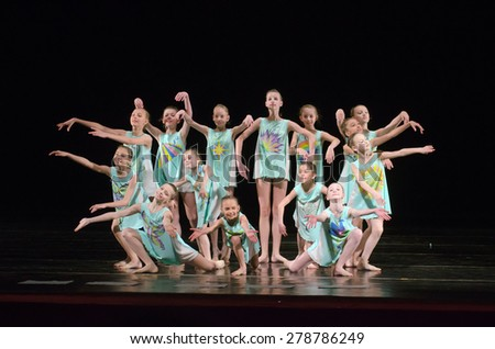 DNIPROPETROVSK, UKRAINE - MAY  16: Unidentified girls, ages 9-13 years old, perform ILLUSTRATION MOTHER at State Opera and Ballet Theatre on May 16, 2015 in Dnipropetrovsk, Ukraine - stock photo