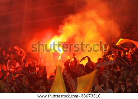 DNIPROPETROVSK, UKRAINE - OCTOBER 10: Ukrainian fans burn the fires and celebrate their victory over England after their FIFA WC2010 qualifying football match on Oct 10, 2009 in Dnipropetrovsk
