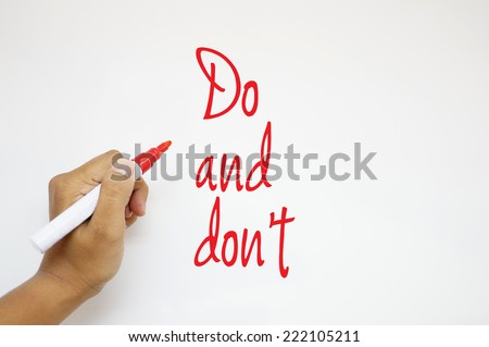Do and don't sign on whiteboard - stock photo